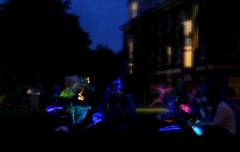 Glowsticks wave at night